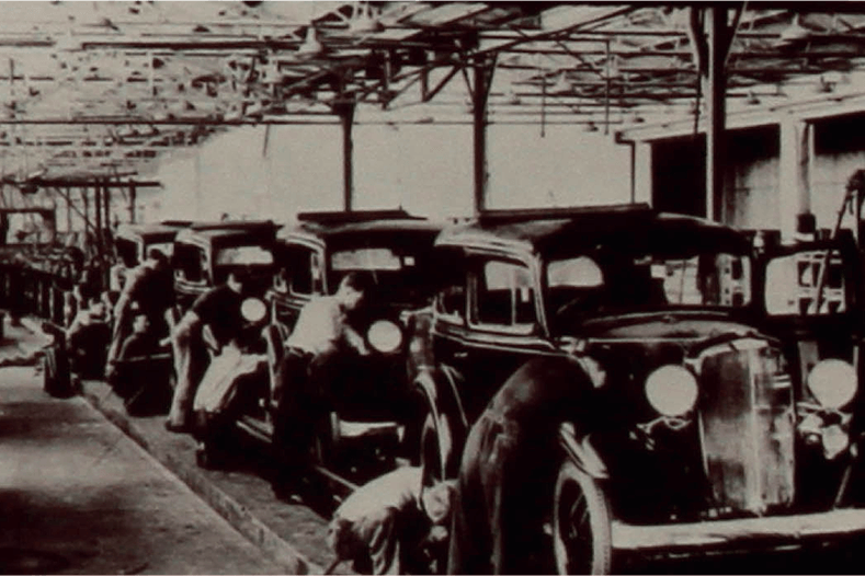 Archive image of old cars on factory line