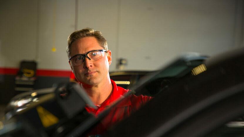 Technician looking over windscreen