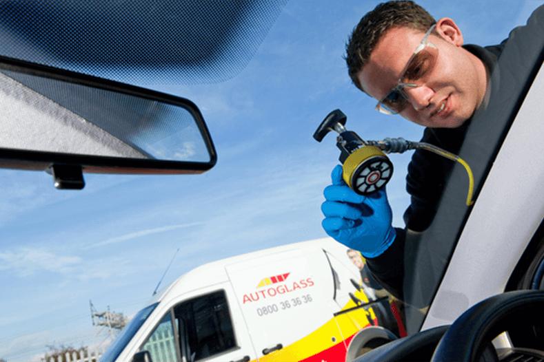 Technician repairing windscreen