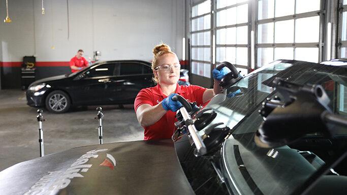 Belron employee fitting windscreen