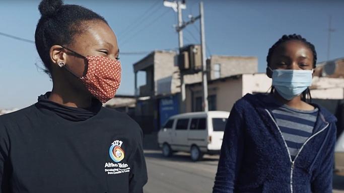 Afrika Tikkun beneficiaries smiling behind facemasks