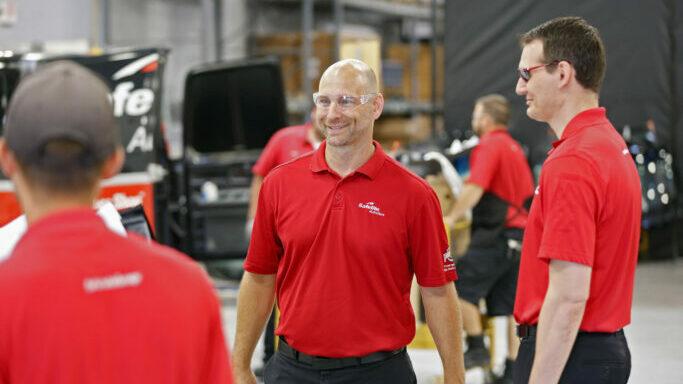 Smiling safelite technicians