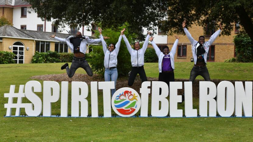 Five children jump over #spiritofbelron sign