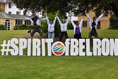Employees jumping behind Spirit Of Belron sign