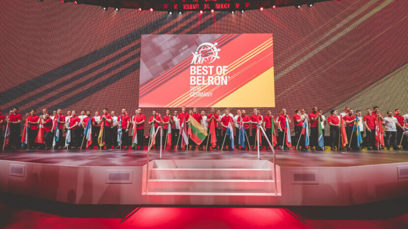 Best of Belron participants on stage with flags