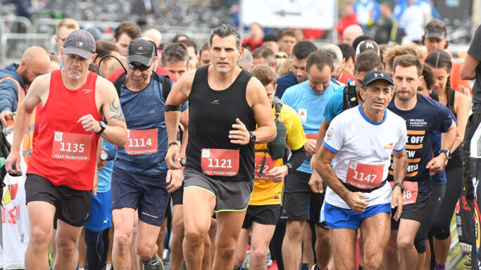 Half marathon runners at start line