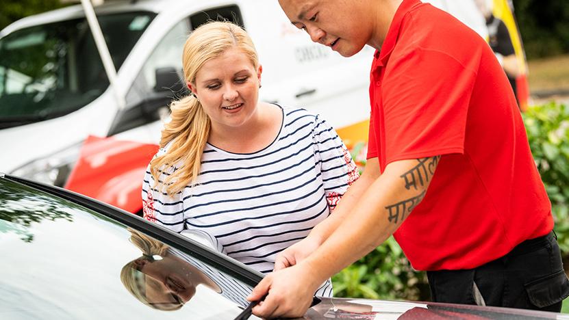 Belron employee talking to customer