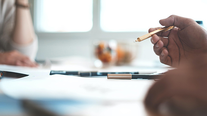 Stock image of person holding pencil